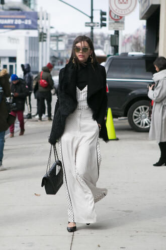 pants nyfw 2017 fashion week 2017 fashion week streetstyle white pants wide-leg pants polka dots top white top turtleneck black turtleneck top bag black bag chain bag vest black vest black fur vest fur vest sunglasses
