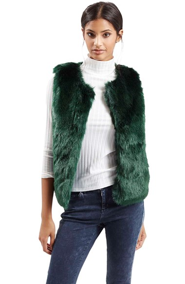 Faux Fur Gilet. Betty Barclay faux fur gilet. Crafted from soft faux shearling, this sleeveless long gilet has draped edging and two front pockets. The long line design features a detachable faux fur collar, long sleeves, side pockets and a button placket down the centre. From Mela London comes this beautifully soft faux fur jacket.