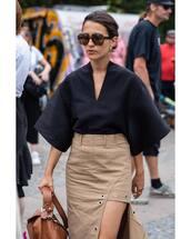 top,black blouse,v neck,asymmetrical,midi skirt,handbag,sunglasses,earrings