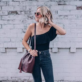 top ruffled top tumblr black top ruffle one shoulder bodysuit black bodysuit denim jeans blue jeans bag bucket bag watch sunglasses spring outfits
