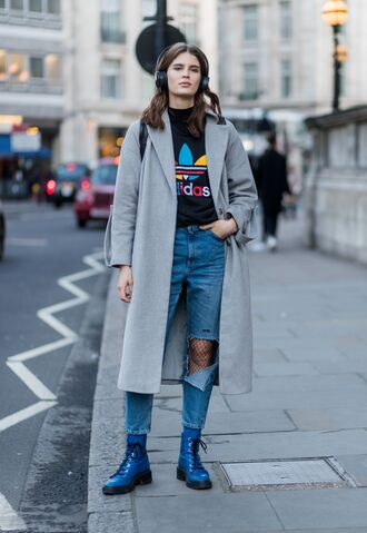 coat london fashion week 2017 fashion week 2017 fashion week streetstyle grey coat denim jeans blue jeans ripped jeans tights net tights fishnet tights boots blue boots biker boots sweatshirt adidas headphones