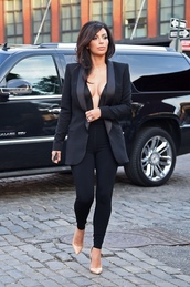 coat,new york city,kim kardashian,candid,meeting,black outfit,low neck line,business clothes,classy,black jeans,cream heels,streetstyle