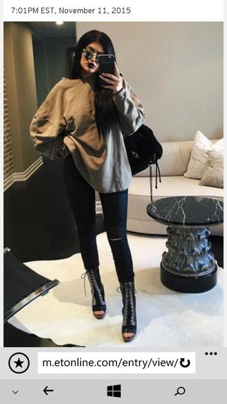 sweater oversized sweater dark lipstick dark dark jeans ripped jeans strappy heels heel boots strappy heels black high heels kylie jenner streetwear streetstyle black green black bag