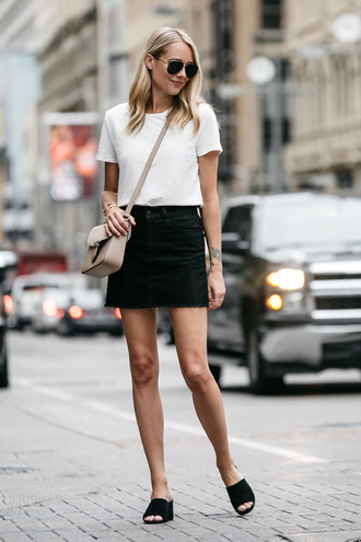 fashionjackson blogger top skirt bag sunglasses jewels crossbody bag black skirt white t-shirt mules summer outfits t-shirt tumblr mini skirt denim denim skirt black denim skirt black flats beige handbag