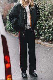 pants,tumblr,fashion week 2017,streetstyle,black pants,wide-leg pants,side stripe pants,jacket,black jacket,black bomber jacket,bomber jacket,hoodie,white hoodie,sneakers,black sneakers