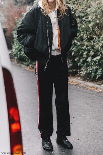pants tumblr fashion week 2017 streetstyle black pants wide-leg pants side stripe pants jacket black jacket black bomber jacket bomber jacket hoodie white hoodie sneakers black sneakers