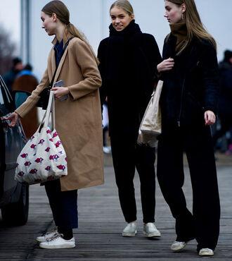 coat tumblr camel coat streetstyle fashion week 2017 girl squad pants black pants wide-leg pants jacket black jacket sneakers white sneakers low top sneakers bag tote bag printed bag scarf