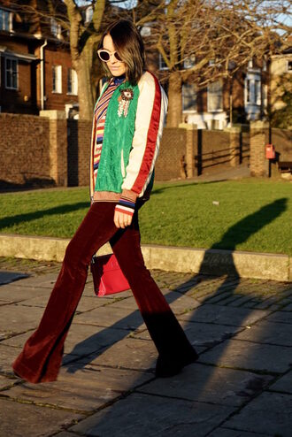 pants tumblr flare pants velvet velvet pants flare velvet pants burgundy burgundy pants jacket baseball jacket green jacket bomber jacket sweater stripes striped sweater 70s style