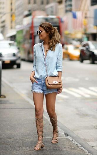 shoes light blue shirt distressed shorts brown purse brown lace up sandals blogger sunglasses