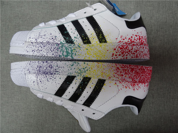 adidas superstar with paint splashes