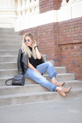 blonde bedhead blogger shoes jeans jacket bag jewels leather jacket round sunglasses black top wide-leg pants nude boots black bag stacked wood heels
