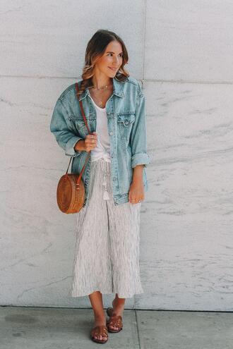 twenties girl style blogger pants t-shirt shoes jacket bag jewels denim jacket round bag sandals spring outfits