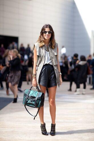 jacket white shirt leather shorts grey vest green bag studded heels blogger sunglasses