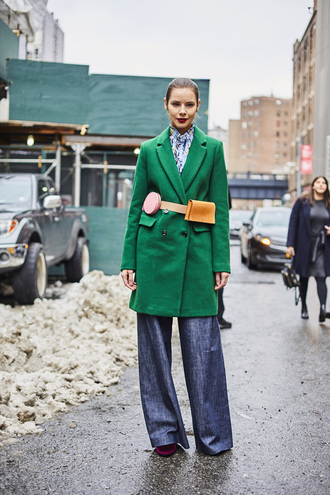 coat tumblr green coat belt bag top printed top nyfw 2017 fashion week 2017 fashion week streetstyle pants denim jeans wide-leg pants blue jeans winter outfits winter look 00s style