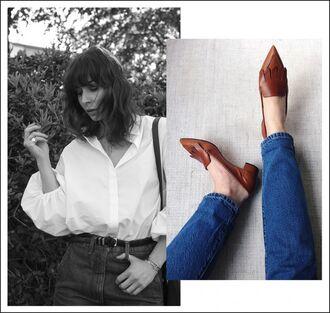 a portable package blogger shirt jeans belt