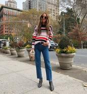 jeans,black boots,heel boots,sweater,sunglasses,streetwear