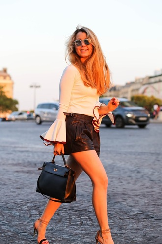 caroline louis pardonmyobsession blogger shoes bag white top long sleeves bell sleeves leather black shorts black bag mini bag sandals