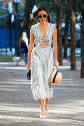 jumpsuit,pants,blogger,sandals,jamie chung,hat,stripes,striped top,palazzo jumpsuit,cropped jumpsuit,cut-out,round sunglasses,straw hat,sun hat,black bag,summer outfits,nude sandals