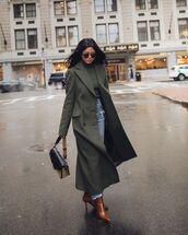 coat,long coat,green coat,boots,brown boots,jeans