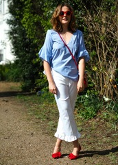 blogger,shirt,pants,sunglasses,bag,shoes,red shoes,red bag,blue top,white pants,spring outfits
