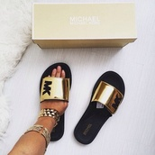 shoes,gold,michael kors shoes,gold shoes,slide shoes,metallic shoes,michael kors,slippers,michael kors slides,metallic slides,sandals,black,mk sandals,metallic gold