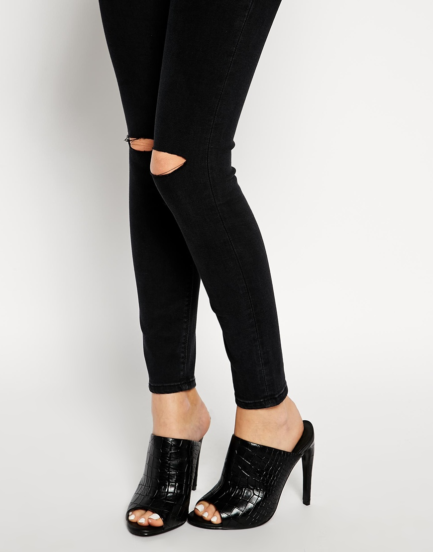 Asos ridley skinny ankle grazer jeans in washed black with displaced knee rips at asos.com