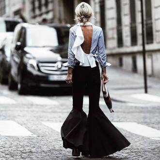 pants tumblr black pants flare pants shirt ruffle ruffled top ruffle shirt open back backless top backless spring outfits bag printed pouch pouch ruffled back shirt black flared pants black heels blogger open back shirt sexy shirt date outfit