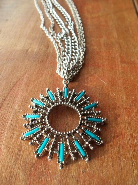 Turquoise sunburst pendant on multistrand by jewelrybyjesse