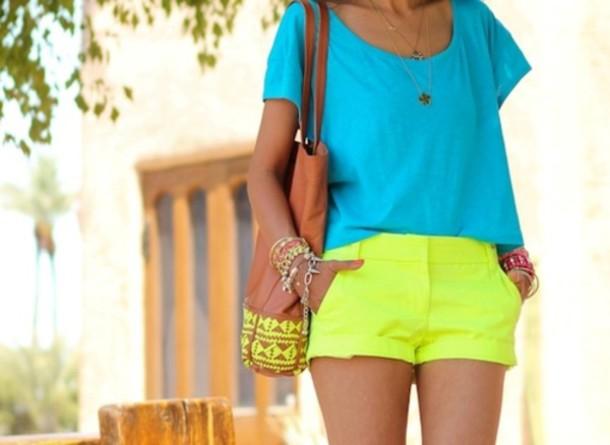 Top: blue, shirt, neon, bright, yellow, shorts, bracelets ...