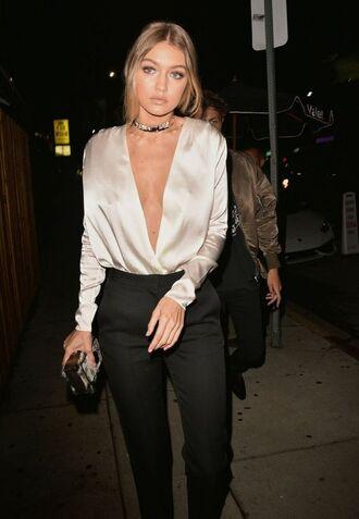 top gigi hadid celebrity celebrity style plunge v neck v neck silk top white top necklace choker necklace pants black pants clutch