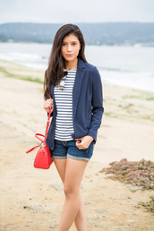 top,blue white red outfit,blue blazer,blazer,striped top,stripes,shorts,denim shorts,blue shorts,bag,red bag,sunglasses,mirrored sunglasses
