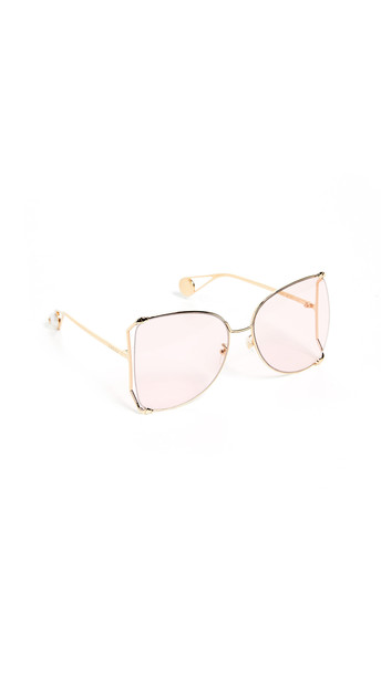 Gucci Cruise Snake Sunglasses in gold / pink
