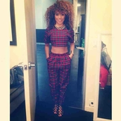 pants,blouse,plaid,pattern,checkerboard,outfit,curly hair