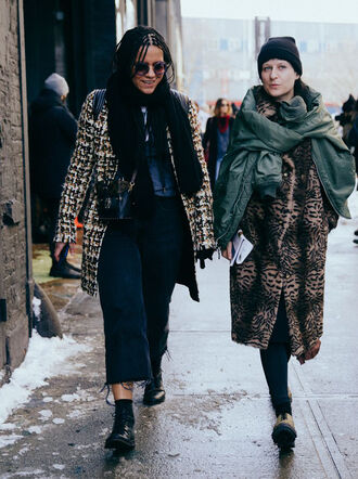 coat nyfw 2017 fashion week 2017 fashion week streetstyle scarf printed coat black leggings leggings boots black boots flat boots ankle boots denim jeans blue jeans cropped jeans sunglasses beanie black beanie