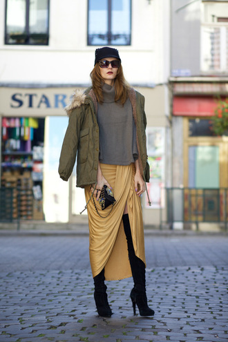 from brussels with love blogger draped skirt parka khaki