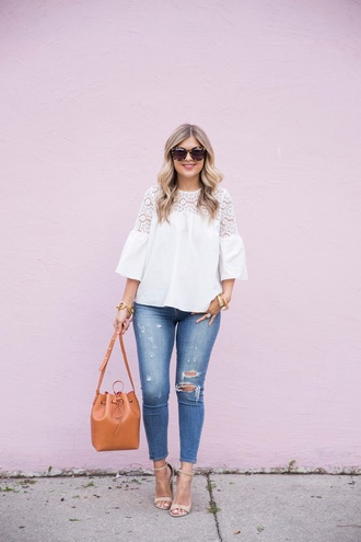 suburban faux-pas blogger blouse jeans shoes bag jewels sunglasses bucket bag brown bag bell sleeves white lace top lace top ripped jeans blue jeans tortoise shell tortoise shell sunglasses sandals sandal heels