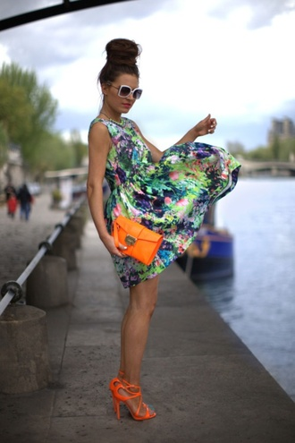 dress floral colorful beautiful print neon orange neon orange clutch sandals purse sunglasses bun nail polish white blue green pink purple shoes top knot bun
