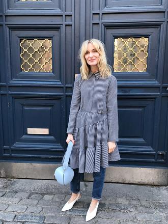 blameitonfashion blogger dress jeans shoes bag dress over pants blue bag spring outfits
