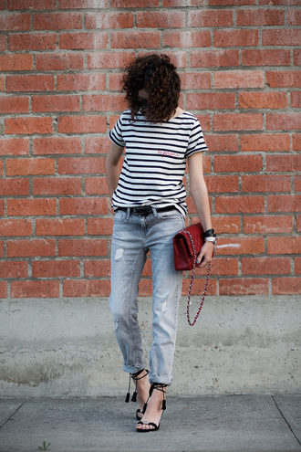 alterations needed blogger jeans jewels sunglasses belt striped shirt black heels red bag chanel boyfriend jeans