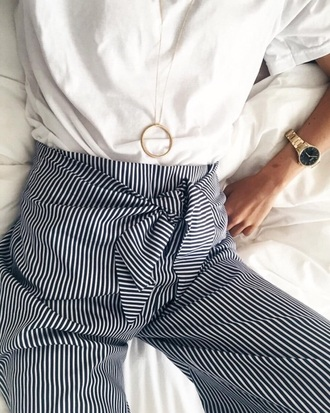 pants striped pants high waisted pants minimalist jewelry stripes white shirt gold necklace pendant gold watch knot necklace
