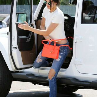 bag t-shirt jeans ripped jeans kendall jenner purse neon neon bag orange orange neon white t-shirt distressed jeans designer little bag handbag neon handbag