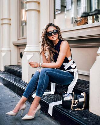 top tumblr lace up black top denim jeans blue jeans skinny jeans pumps pointed toe pumps nude heels sunglasses shoes