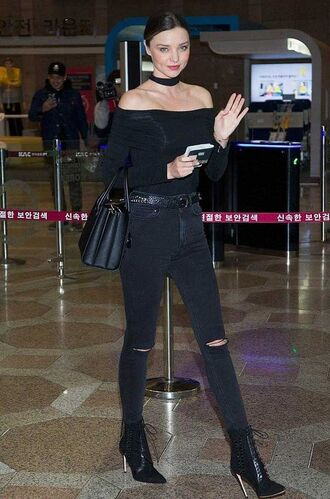 top off the shoulder top black jeans ripped jeans prada lace up boots off the shoulder black off the shoulder top prada bag choker top miranda kerr