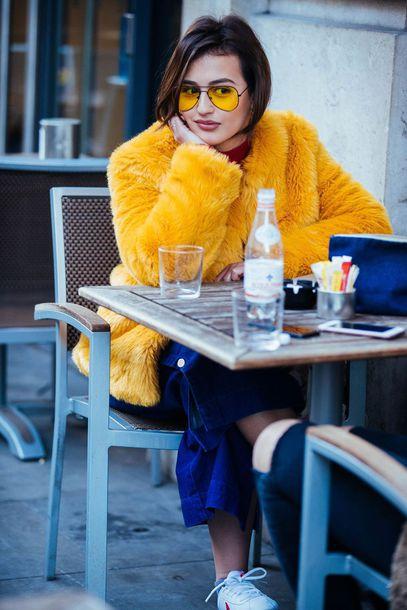 sunglasses london fashion week 2017 fashion week 2017 fashion week streetstyle yellow yellow sunglasses yellow jacket pants blue pants wide-leg pants aviator sunglasses fur jacket