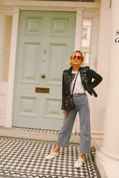 shoes,pants,stripes,top,jacket,leather jacket,sneakers,sunglasses