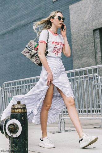 skirt fashion week street style fashion week streetstyle asymmetrical asymmetrical skirt wrap skirt striped skirt stripes t-shirt white t-shirt bag gucci gucci bag dionysus sunglasses white sneakers sneakers low top sneakers