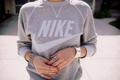 sporty chic,nike,grey sweater,nike sweater,sports sweater,athleisure,silver jewelry,sweater,oversized sweater,winter sweater,sexy sweater,cute sweaters,nike sportswear,white,jewels,jewelry,silver,silver ring,ring,bracelets,clothes,grey