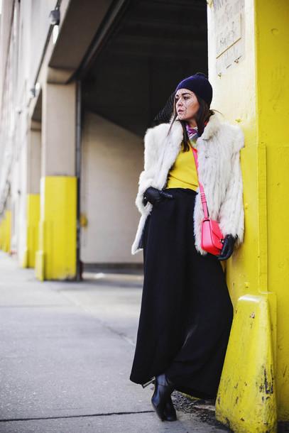 style scrapbook blogger fur coat white coat yellow top red bag shoulder bag black pants black boots winter outfits hat