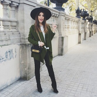 green coat big hat black hat blogger black boots moschino forest green