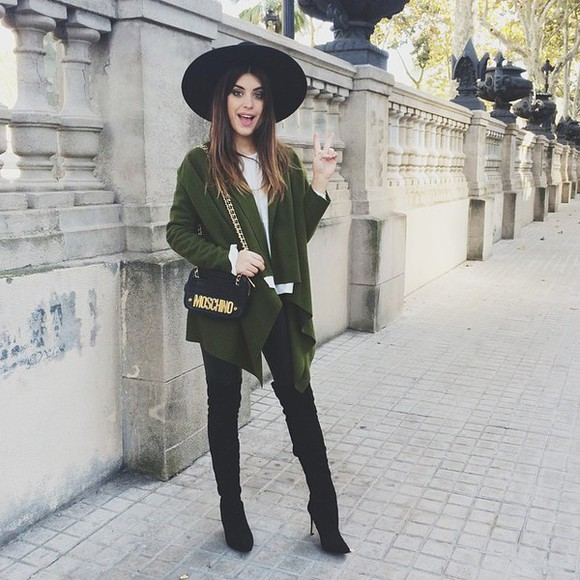 black hat green coat big hat blogger black boots moschino forest green